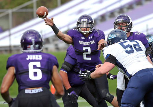 Quarterback Kain Colter (2) of Northwestern throws to Tony Jones (6) for a 27-yard touchdown in the first quarter against Maine at Ryan Field Sept. 21. Northwestern won, 35-21. Credit: Courtesy of MCT