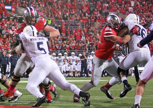 Redshirt-senior offensive lineman Jack Mewhort (74) blocks a defender during a game against Penn State at Ohio Stadium. OSU won, 63-14. Credit: Shelby Lum / Photo editor