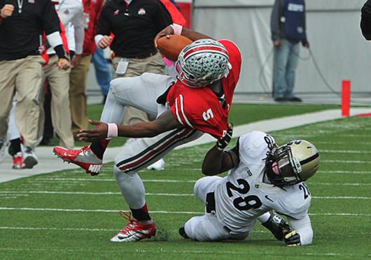 Then-senior Purdue cornerback Josh Johnson (28) tackles then-sophomore quarterback Braxton Miller (5) during a game against Purdue Oct. 20, 2012, at Ohio Stadium. OSU won, 29-22. Lantern file photo