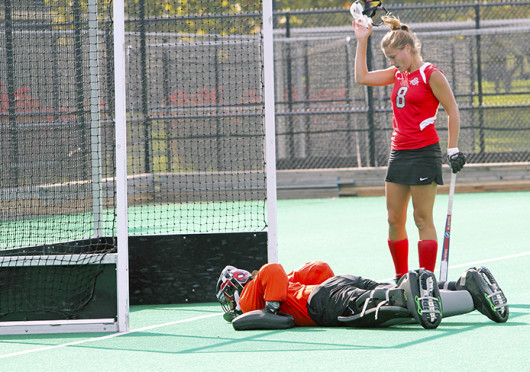 Senior midfielder Mona Frommhold (8) stands over her goalkeeper during a match against Louisville Oct. 1 at Buckeye Varsity Field. OSU lost, 6-3. Credit: Ritikia Shah / Asst. photo editor
