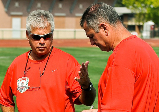 Men's soccer coaches John Bluem (left) and Frank Speth discuss strategy before a game against Cal State Fullerton Sept. 6, 2009, at Jesse Owens Memorial Stadium. OSU won, 1-0. Credit: Courtesy of OSU athletics