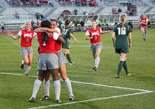 Freshman forward Nichelle Prince (7) celebrates a goal with her teammates during a match against Michigan State Oct. 12 at Jesse Owens Memorial Stadium. OSU won, 3-1. Credit: Daniel Rogers / Asst. sports editor