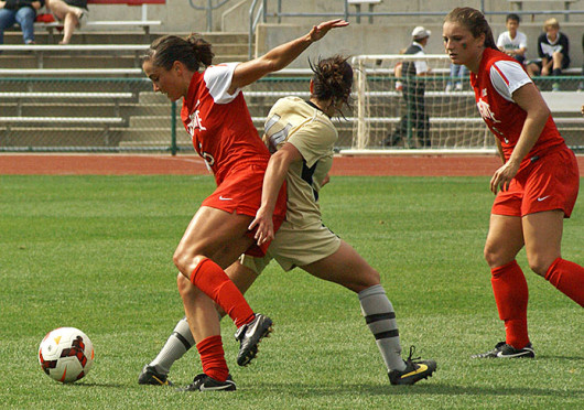 Junior midfielder Ellyn Gruber (5) fights off a defender during a match against Purdue Sept. 29 at Jesse Owens Memorial Stadium. OSU lost, 1-0. Credit: Michele Theodore / Copy chief