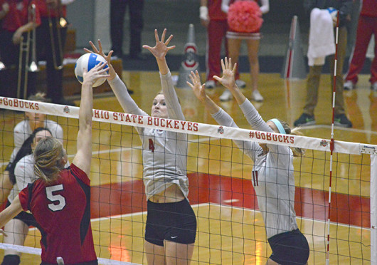 Sophomore middle blocker Andrea Kacsits defends a shot during a match against Nebraska Oct. 25 at St. John Arena. OSU lost, 3-1. Credit: Brandon Klein / Lantern photographer