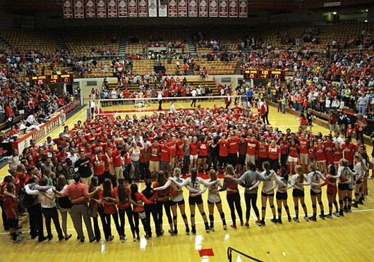 The Ohio State women's volleyball team celebrates a victory against Michigan Sept. 27 at St. John Arena. OSU won, 3-1. Credit: Mark Batke / Lantern photographer