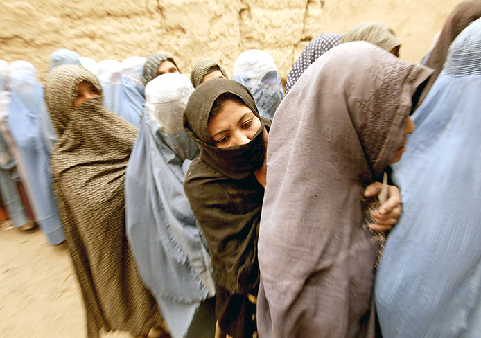 Afghani women line up to vote during the first democratic presidential election in Kabul, Afghanistan, Oct.9, 2004.