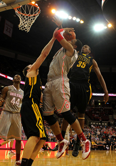 Former OSU forward Jared Sullinger, center, plays in a game against Iowa. Sullinger plays as a forward for the Boston Celtics and appeared in 45 games in his rookie season.