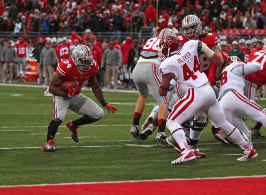 Senior running back Carlos Hyde (34) jukes a defender during a game against Indiana Nov. 23 at Ohio Stadium. OSU won, 42-14. Credit: Shelby Lum / Photo editor