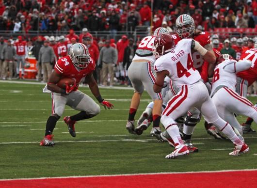 Senior running back Carlos Hyde (34) jukes a defender during a game against Indiana Nov. 23 at Ohio Stadium. OSU won, 42-14. Credit: Shelby Lum / Photo editor
