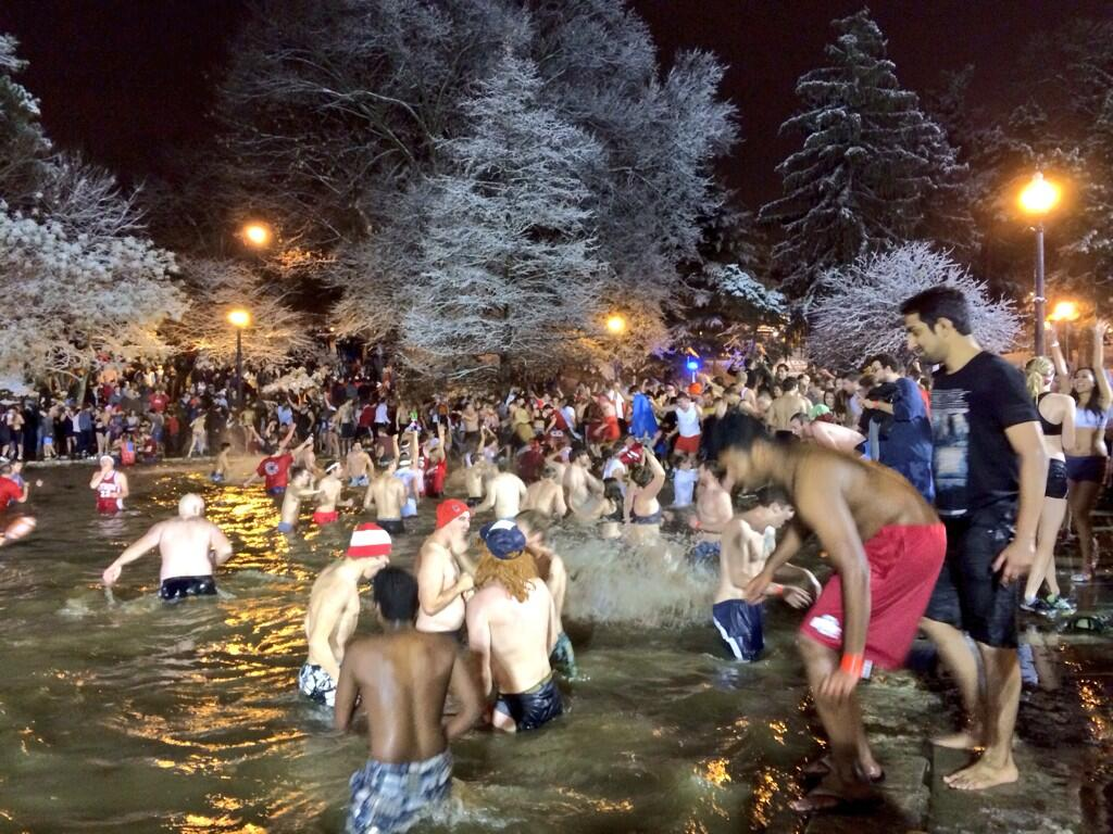 OSU fans jump into Mirror Lake Nov. 26 as part of a university tradition, though the event is not officially university-sanctioned. Credit: Liz Young / Campus editor