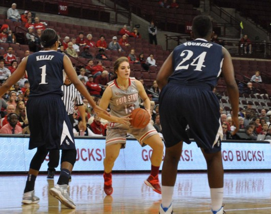Sophomore guard Cait Craft (13) looks for an open pass during a game against Old Dominion Nov. 22 at the Schottenstein Center. OSU won, 75-60. Credit: Liz Young / Campus editor
