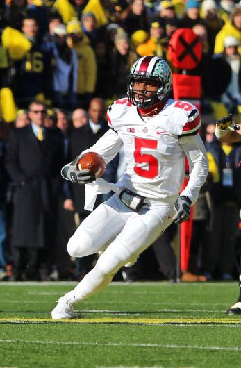 Junior quarterback Braxton Miller (5) runs the ball during a game against Michigan Nov. 30 at Michigan Stadium. OSU won, 42-41. Credit: Kaily Cunningham / Multimedia editor