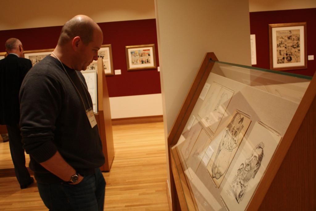 Michael Davis of Cleveland views a Basil Volverton piece inside the new Billy Ireland Cartoon Library and Museum in Sullivant Hall Nov. 15. Credit: Matthew Lovett / Lantern photographer