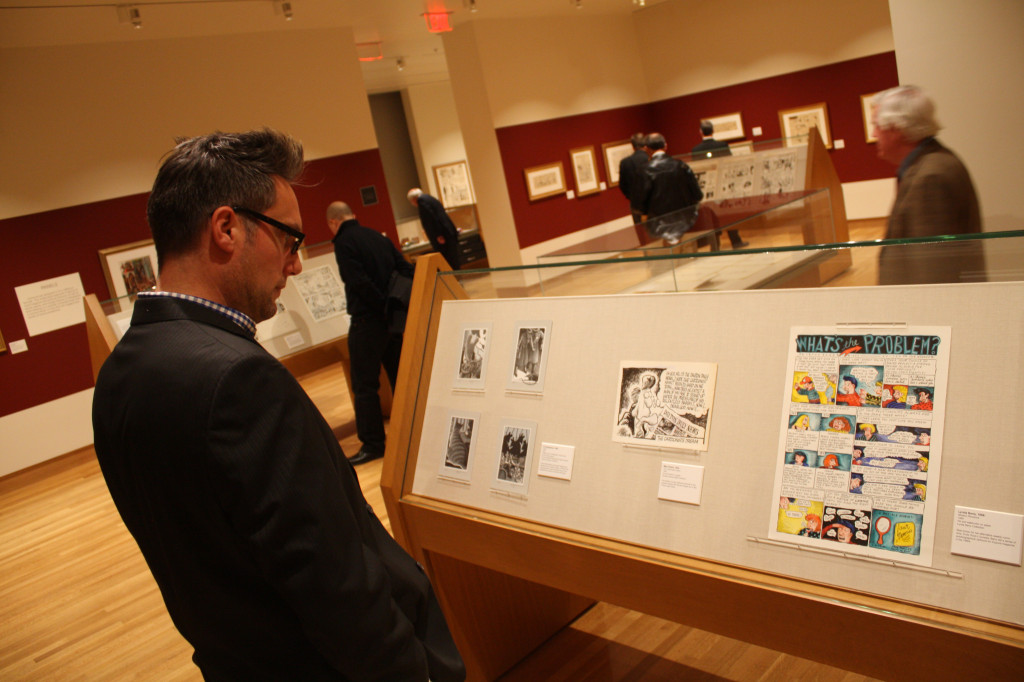 Niels Braam of Columbus views a print from cartoonist Art Spiegelman at the newly opened Billy Ireland Cartoon Library and Museum in Sullivant Hall Nov. 15. Credit: Matthew Lovett / Lantern photographer