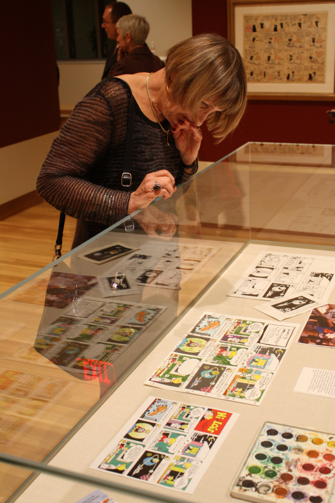 Linda Larrimer of Columbus glances at 'Hi and Lois' comic strips in the new gallery space of the Billy Ireland Cartoon Library and Museum during its grand opening ceremony in Sullivant Hall Nov.15. Credit: Matthew Lovett / Lantern photographer