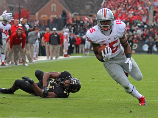 Freshman running back Ezekiel Elliott (15) runs toward the end zone during a game against Purdue Nov. 2 at Ross-Ade Stadium. OSU won, 56-0. Credit: Shelby Lum / Photo editor