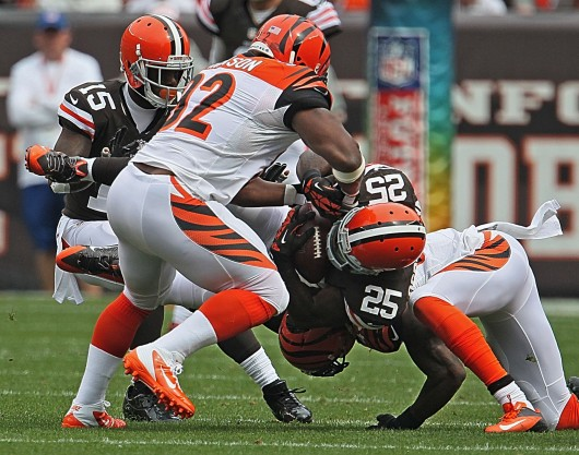 Cleveland Browns running back Chris Ogbonnaya (25) is upended by Cincinnati Bengals safety George Iloka, right, during a game at FirstEnergy Stadium. The Browns won, 17-6. Credit: Courtesy of MCT