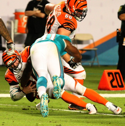 Cincinnati Bengals quarterback Andy Dalton is sacked by Miami Dolphins defense end Cameron Wake during a game at Sun Life Stadium Oct. 31. Miami won, 22-20 in overtime. Credit: Courtesy of MCT
