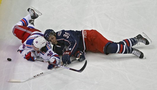 Michael Chaput (39) of the Columbus Blue Jackets and Mats Zuccarello (36) of the New York Rangers battle for a puck during a game at Nationwide Arena Nov. 7. The Rangers won, 4-2. Credit: Courtesy of MCT