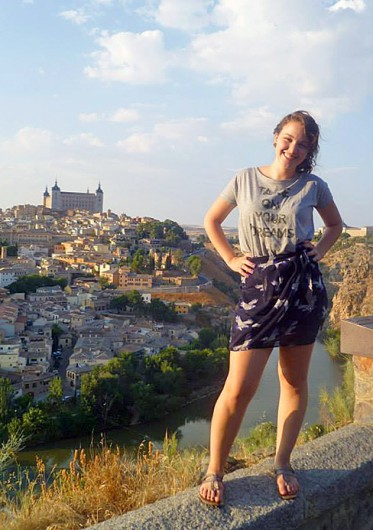 Michele Theodore stands atop a hill overlooking Toledo, Spain