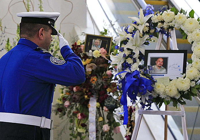 A TSA honor guard salutes the picture of slain TSA officer Gerardo Hernandez at Los Angeles International Airport's Terminal 3 during a moment of silence Nov. 8.