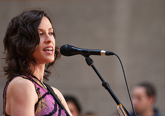 Alanis Morissette performs live on the Plaza at Rockefeller Center, in New York City September 2003. It was recently announced the singer's album 'Jagged Little Pill' would be turned into a musical.  Credit: Courtesy of MCT