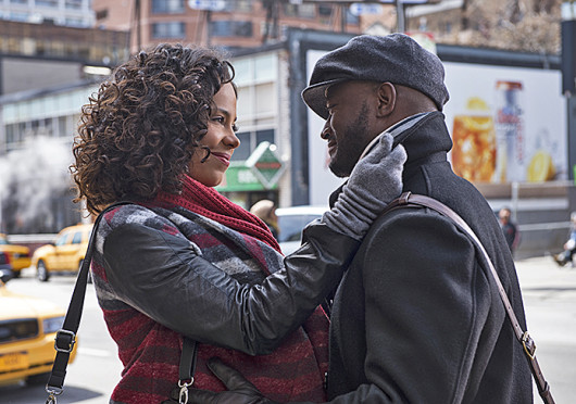 Sanaa Lathan (Robyn), left, and Taye Diggs (Harper) smile during a scene from 'The Best Man Holiday,' which is set to hit theaters Nov. 15.  Credit: Courtesy of NBCUniversal