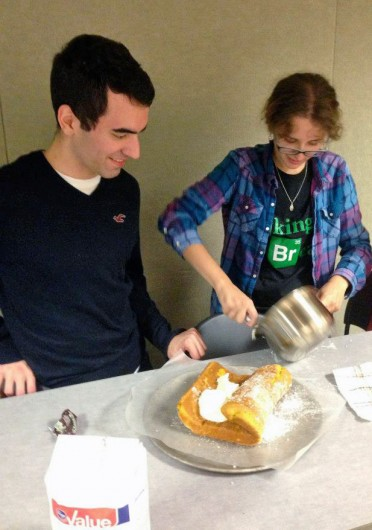 OSU Bread Club members Michael Mascolino (left) and Erica Cramer, primary leader of the club, make a pumpkin roll.  Credit: Courtesy of Matthew Pham