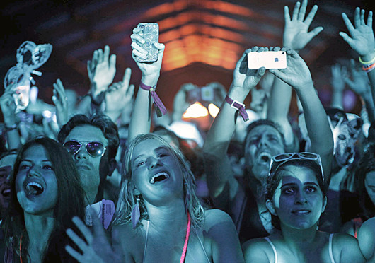 Audience members sing, watch and hold up their phones during DJ Kaskade's set at the Coachella festival in Indio, Calif. April 21, 2012. Credit: Courtesy of MCT