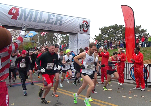 Participants of the first OSU 4-Miler race cross run the course Nov. 10. Some proceeds from the event went toward the Urban and Shelley Meyer Fund of Cancer Research. Credit: Gina Davis / BuckeyeTV reporter