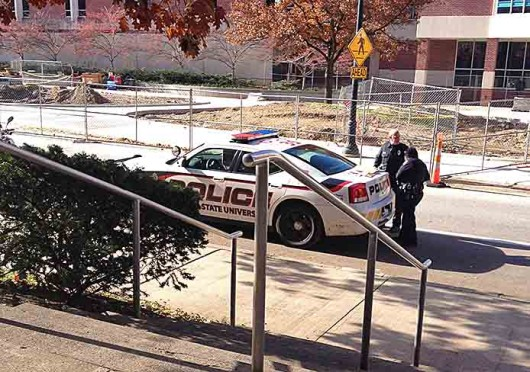 A man is arrested on an active felony theft warrant at the Journalism Building Nov. 18 around 11 a.m. Credit: Shelby Lum / Photo editor