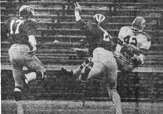 OSU running back Paul Warfield (42) catches a 35-yard pass from quarterback Don Unverferth late in the second quarter for a touchdown against Michigan Nov. 30, 1963. OSU won, 14-10. Credit: AP wirephoto published by The Lantern Dec. 2, 1963