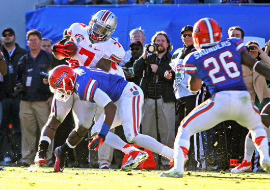 Then-junior running back Jordan Hall (7) is tackled during the Gator Bowl in Jacksonville, Fla. OSU lost to Florida, 24-17, Jan. 2, 2012. Credit: Lantern fil photo