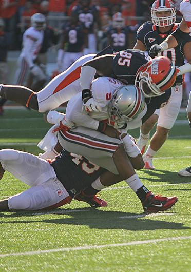 Then-freshman OSU quarterback Braxton Miller (5) is tackled during a game against Illinois Oct. 15, 2011. OSU won, 17-7. Credit: Lantern file photo