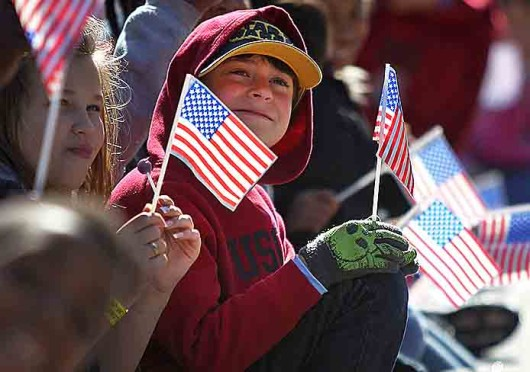Andy Bowers, 11, sits at a Veterans Day Parade in Columbia, S.C., Nov. 8. Credit: Courtesy of MCT