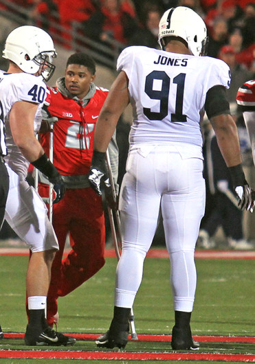 Senior safety Christian Bryant (2) walks out with the other OSU football captains for the coin toss before a game against Penn State Oct. 26 at Ohio Stadium. OSU won, 63-14. Credit: Shelby Lum / Photo editor