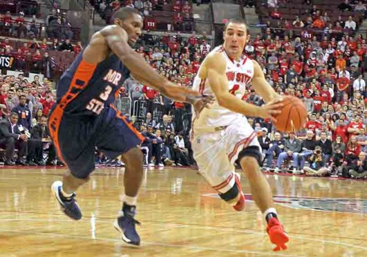 Senior guard Aaron Craft (4) drives to the basket during a game against Morgan State Nov. 9 at the Schottenstein Center. OSU won, 89-50. Credit: Shelby Lum / Photo editor