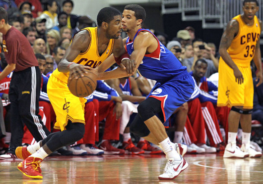 Cleveland Cavaliers guard Kyrie Irving (left) attempts to beat the defender during a preseason game against the Philadelphia 76ers Oct. 21 at the Schottenstein Center. Cleveland won, 104-93. Credit: Shelby Lum / Photo editor