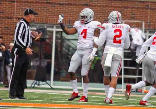 Redshirt-senior safety C.J. Barnett (4) celebrates an interception during a game against Illinois Nov.  16 at Memorial Stadium. OSU won, 60-35. Credit: Shelby Lum / Photo editor