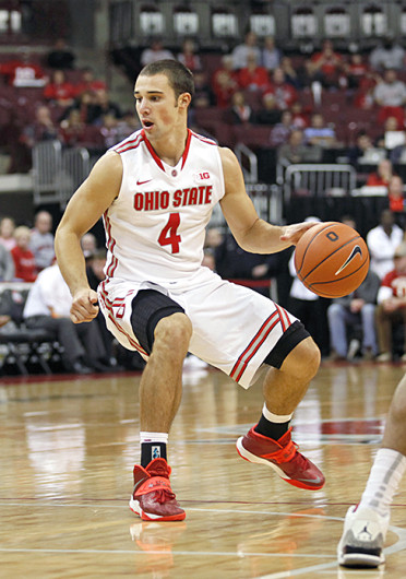 Senior guard Aaron Craft (4) looks for an opening during a game against Walsh Nov. 3 at the Schottenstein Center. OSU won, 93-63. Credit: Kelly Roderick / For The Lantern