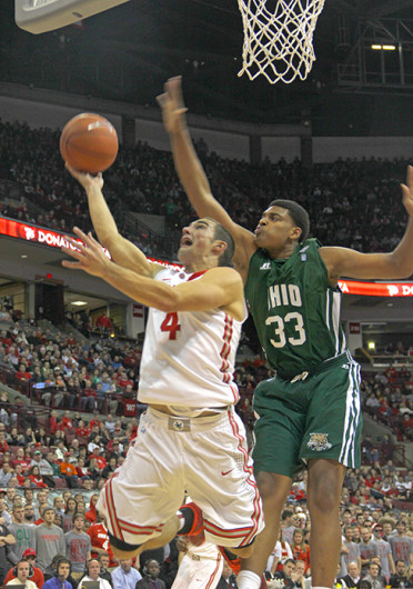 Senior guard Aaron Craft (4) attempts a lay up during a game against Ohio Nov. 12 at the Schottenstein Center. OSU won, 79-69. Credit: Ritika Shah / Asst. photo editor