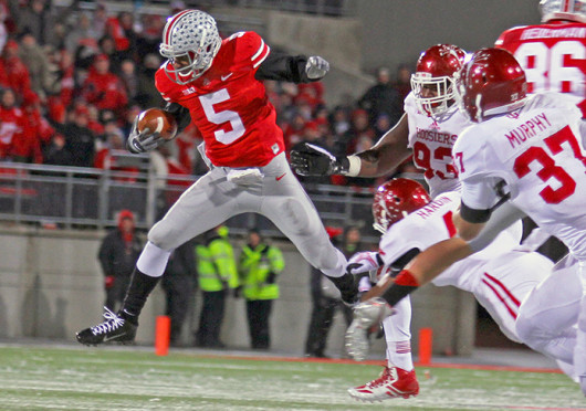 Junior quarterback Braxton Miller (5) runs the ball during a game against Indiana Nov. 23 at Ohio Stadium. OSU won, 42-14. Credit: Shelby Lum / Photo editor