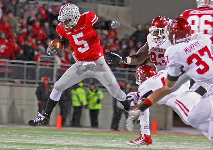 Then-junior quarterback Braxton Miller (5) runs the ball during a game against Indiana Nov. 23 at Ohio Stadium. OSU won, 42-14. On Thursday night, Miller announced that he would be changing positions for the upcoming season. Credit: Lantern file photo