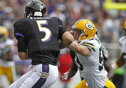Green Bay Packers inside linebacker A.J. Hawk (50) pressures Baltimore Ravens quarterback Joe Flacco (5) Oct. 13 at M&T Bank Stadium. The Packers won, 19-17. Credit: Courtesy of MCT