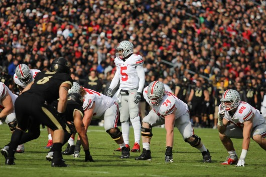 Junior quarterback Braxton Miller (5) scans the field during a game against Purdue Nov. 2 at Ross-Ade Stadium. OSU won, 56-0. Credit: Shelby Lum / Photo editor