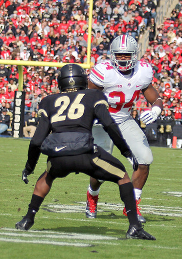 Senior running back Carlos Hyde (34) attempts to avoid a defender during a game against Purdue Nov. 2 at Ross-Ade stadium. OSU won, 56-0. Credit: Shelby Lum / Photo editor