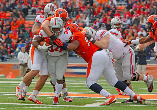Senior running back Carlos Hyde (34) is hit by defenders during a game against Illinois Nov. 16 at Memorial Stadium. OSU won, 60-35. Credit Shelby Lum / Photo editor