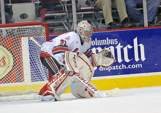 Freshman goalie Matt Tomkins (31) prepares to make a save during a game against Bowling Green Oct. 29 at the Schottenstein Center. OSU won, 5-3. Credit: Shelby Lum / Photo editor
