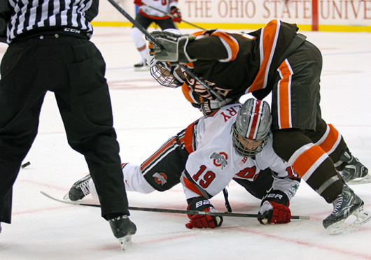 Junior forward Chad Niddery fights for the puck during a game against Bowling Green Oct. 29 at the Schottenstein Center. OSU won, 5-3. Credit: Shelby Lum / Photo editor