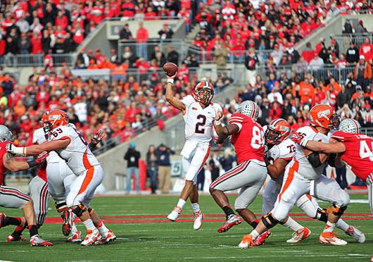Then-redshirt-junior Illinois quarterback Nathan Scheelhaase (2) throws the ball during a game against Ohio State Nov. 3, 2012, at Ohio Stadium. OSU won, 52-22. Credit: Lantern file photo